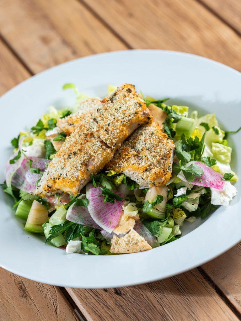 Garlic Herb-Crusted Local Mahi-Mahi over Middle Eastern Fattoush Salad by chef Tim Nickey, Photo by Benjamin Rusnak