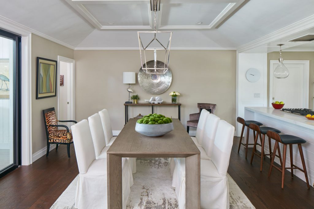 Millwork on the tray ceiling adds elegance to the dining space. Below: A unique blue coat of Farrow & Ball paint makes the bathroom pop.