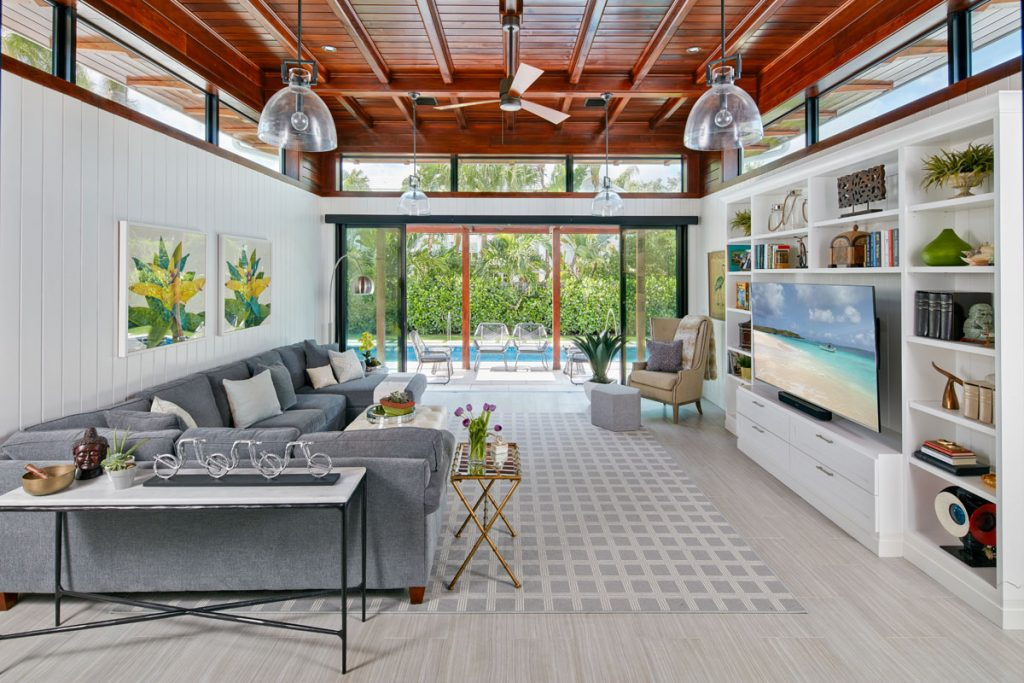 Rill converted a screened-in porch into  a sun-filled living area that opens to the pool.