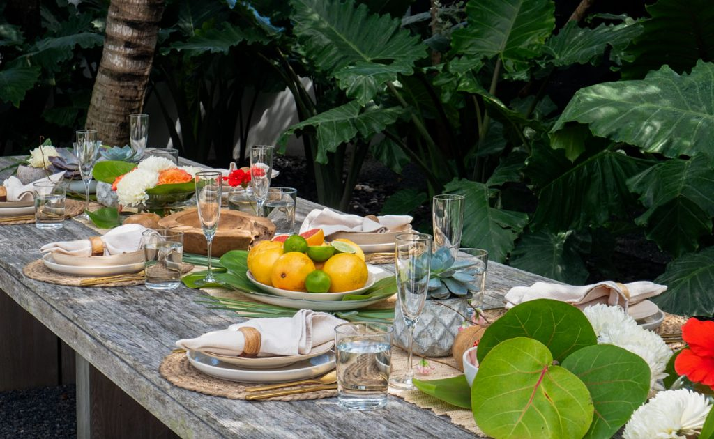 Lauren tries to make every family meal special and doesn't hold back on the decor. Here, the teak table in the backyard is set for lunch with greenery and flowers she pulled from their property.