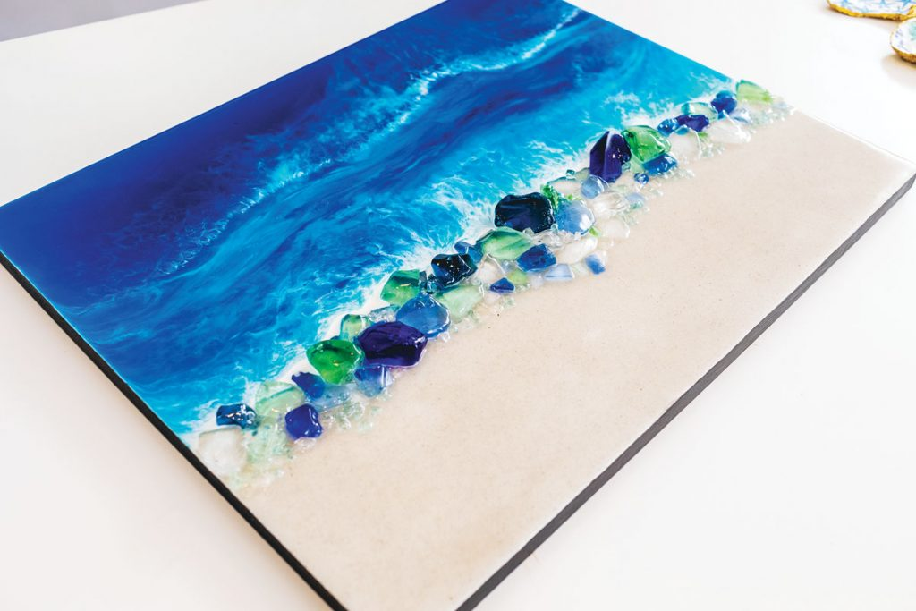 Here, she incorporated sea glass and sand from Siesta Key, Florida, Photography by Stay Gold Photo