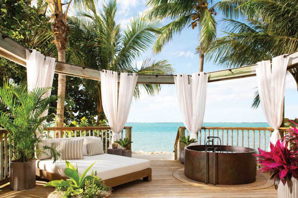 The balcony of a Romance Suite with gorgeous views. Images courtesy of little palm island resort and spa
