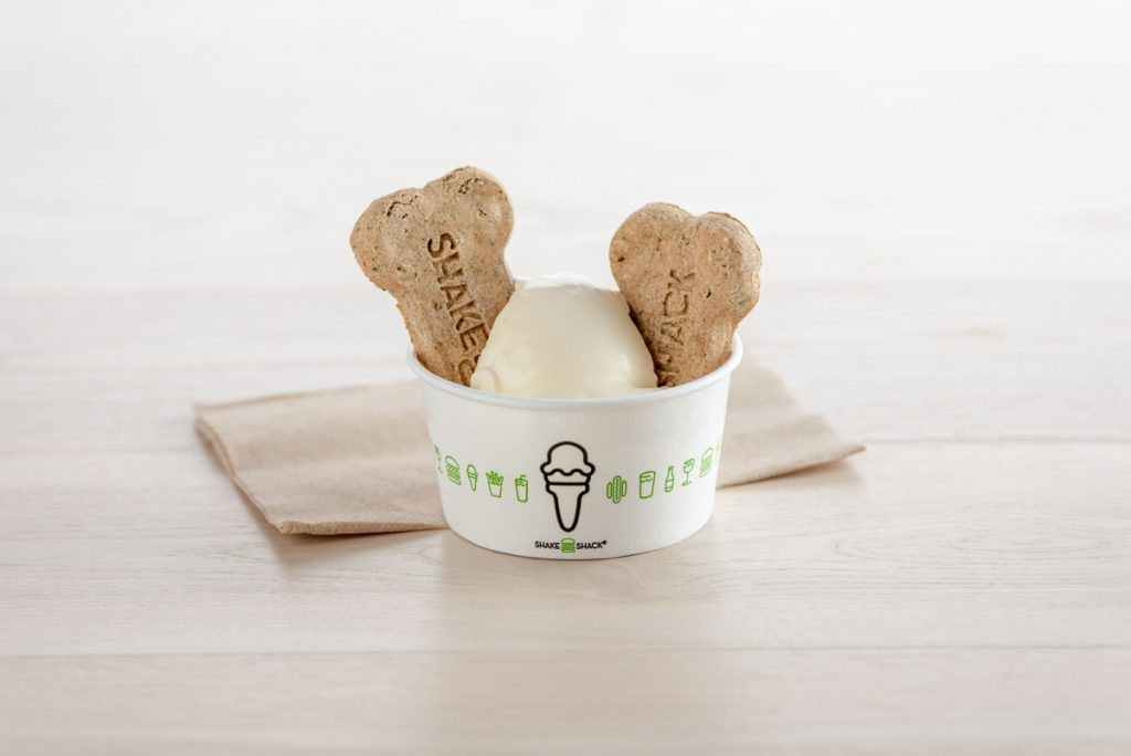 """Treat your best pal to dog biscuits and a vanilla """"Pooch-ini"""" at Shake Shack. Photo courtesy of Shake Shack"""