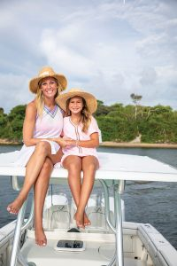 Caroline and Jeanmarie pair their colorful Pitusa cover-ups with fun bracelets by local designer Liv Tova; shot on their boat in the Jupiter Inlet. Photo by Jason Nuttle