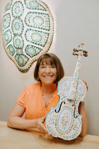 Faith Schwack with her transformed violin.