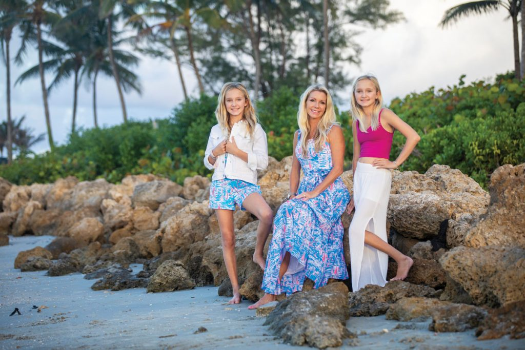 Brea in a Lilly Pulitzer romper, Tracey in a Lilly Pulitzer dress, Lilly in a Lululemon tank and white pants; shot at DuBois Park in Jupiter. Photo by Jason Nuttle