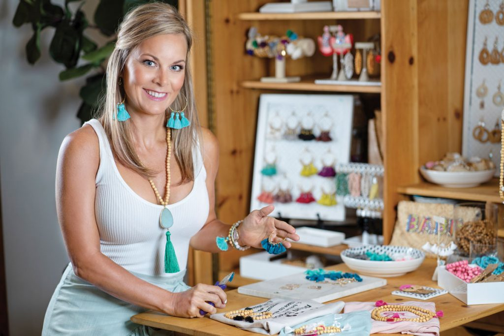 Ashley Belford crafting jewelry in her Jupiter home.
