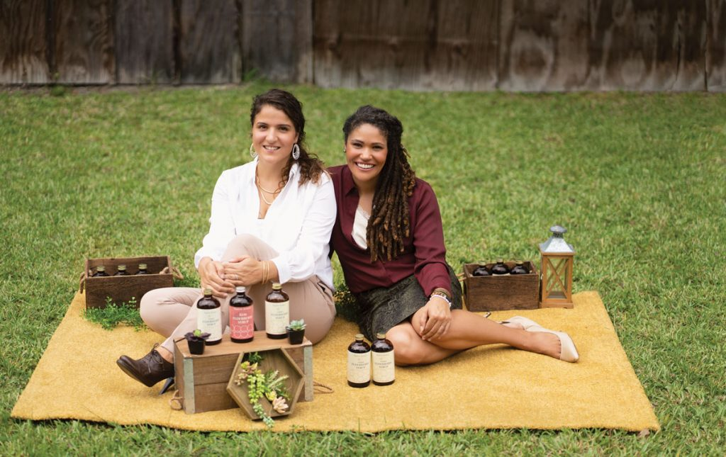 Brittney Hurt (left) and Ashley Lancelot with some of their syrup products in Fort Pierce.
